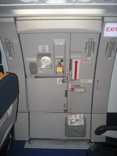 Passenger Mistakes Emergency Door for Lavatory