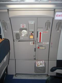Passenger Mistakes Emergency Door for Lavatory